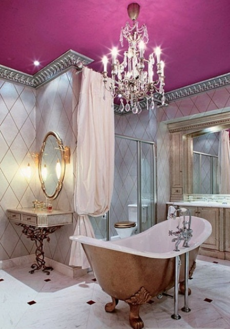 a free-standing antique copper bathtub for a vintage glam bathroom