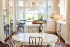12 a rustic shabby chic kitchen with a sheer crystal chandelier on a white chain