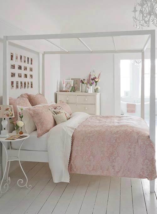 a white bed with holders for hanging curtains if needed looks lightweight