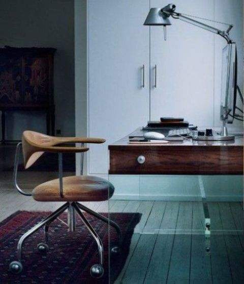 a wooden top with drawers and crylic legs make this contrasting desk a statement one