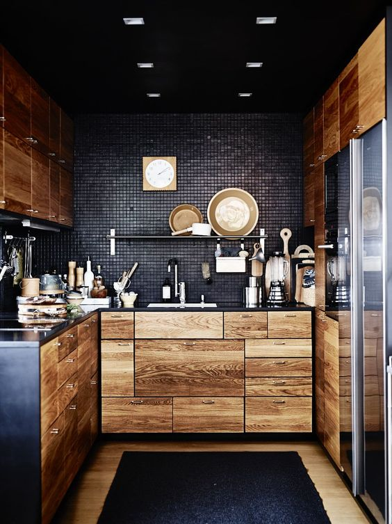 black tiles look stunning with light-colored wooden cabinets