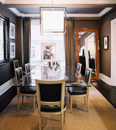 elegant black leather and light wood chairs look gorgeous with a glass top table