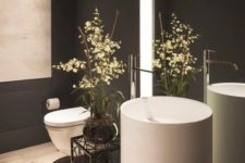 12 gorgeous round free-standing sink in a black bathroom
