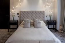 12 modern glass pendant lamp combos on each side of the bed bring a wow factor