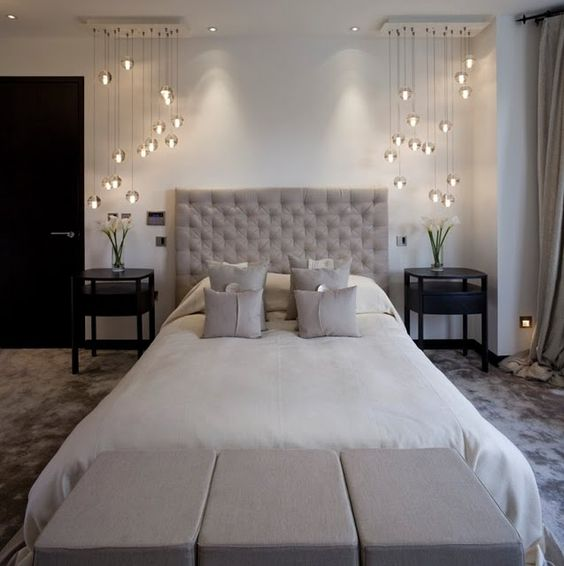 modern glass pendant lamp combos on each side of the bed bring a wow factor