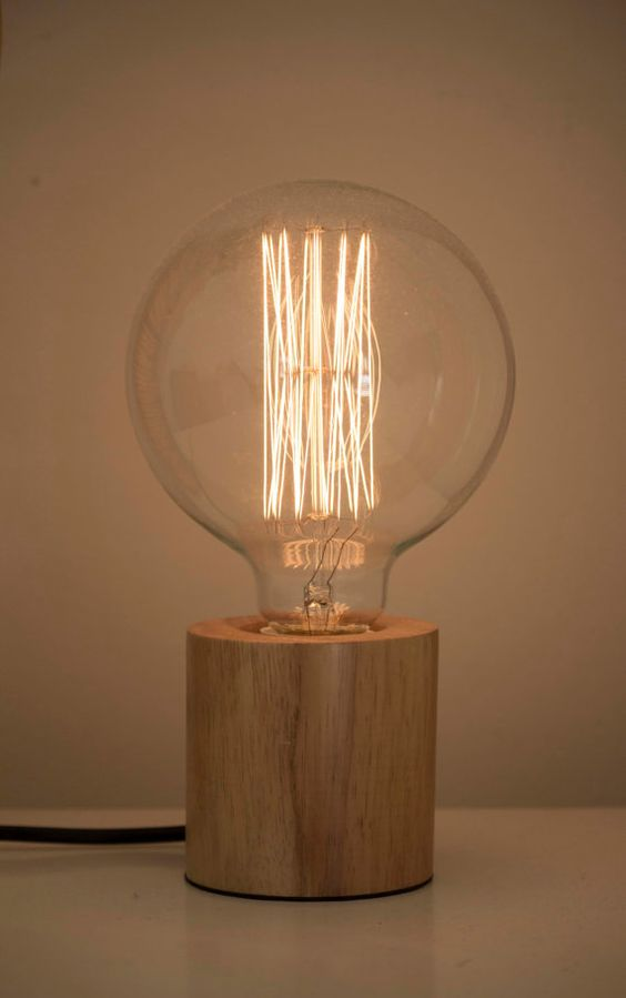 Modern Table Lamp Made Of A Wooden Base And Large Bulb Looks Very Natural