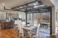 12 the dining space is opened to the deck with the help of garage doors