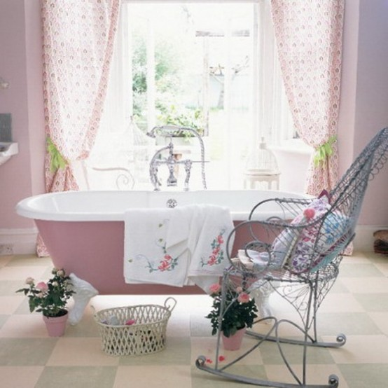 a rustic bathroom with a light pink bathtub