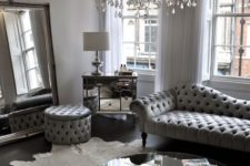 13 a silver grey living room with a large crystal chandelier with candle-inspired bulbs