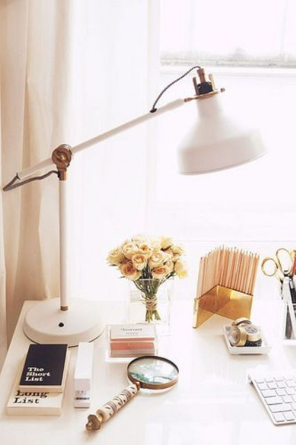 a white modern lamp with brass elements for a glam home office