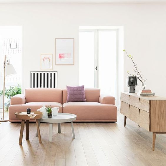 soft modern pink sofa with no legs bleds this Scandinavian room perfectly