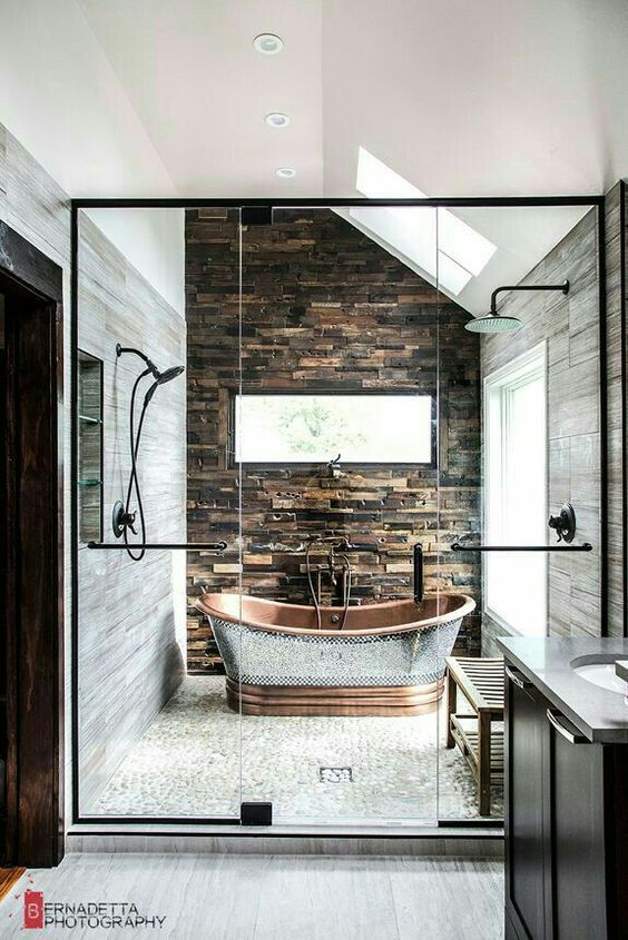 stone, tiles and a metal bathtub in the shower area as a showstopper
