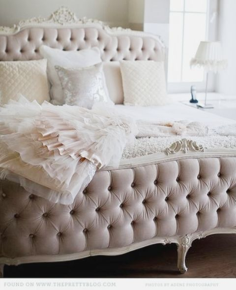 tufted blush bed is a refined perfection for a girlish bedroom