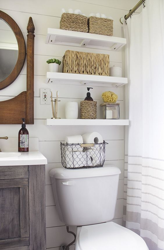 floating shelves for a farmhouse style bathroom and wicker baskets for storage