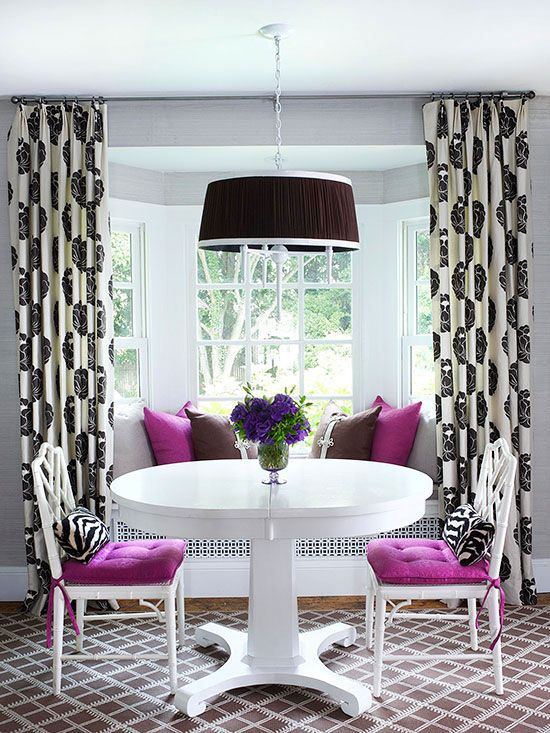 white chairs with purple upholstery and echoing pillows