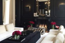 15 a black and white living room is given elegance and chic with a black chandelier and trasparent crystals