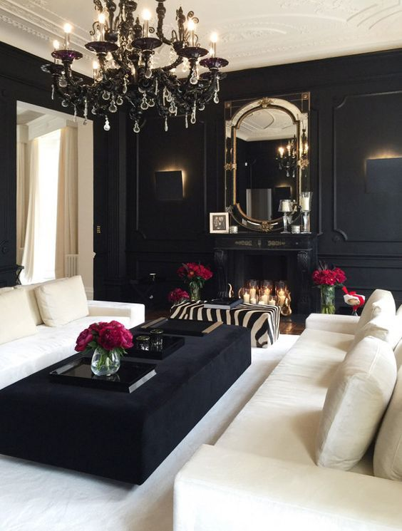 A Black And White Living Room Is Given Elegance And Chic With A Black  Chandelier And