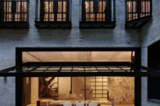 15 black frame garage door that opens a dining space to the outside