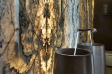 15 black stone sinks inspired by cigars in front of a backlit wall