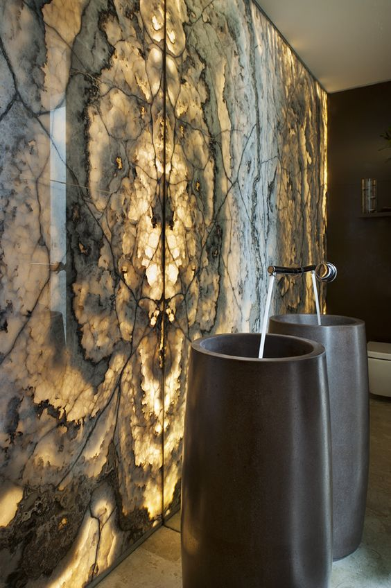 black stone sinks inspired by cigars in front of a backlit wall