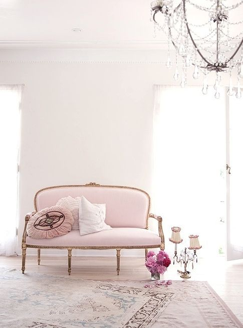 vintage light pink sofa on gilded legs and with an oval-shaped back