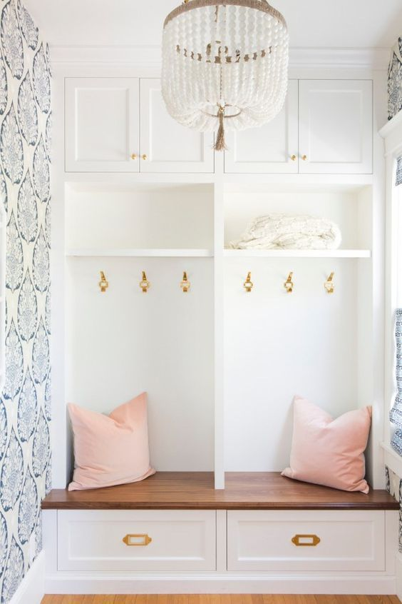 a cute white bead chandelier adds chic to this hallway