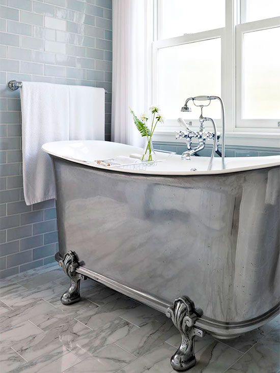 a stunning metallic claw-foot tub with a vintage feel