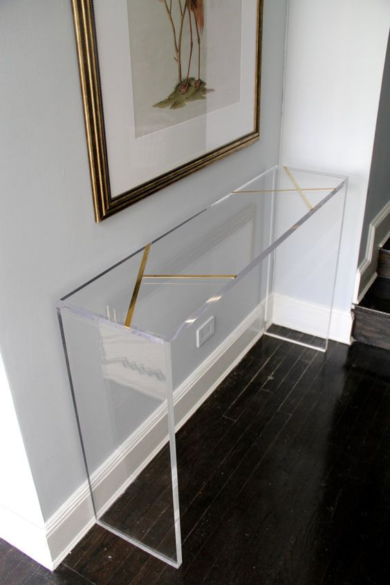 brass inlay lucite console will look very lightweight in an entryway