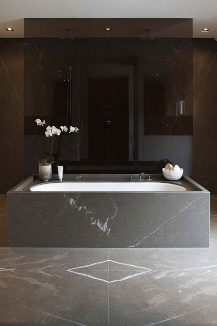 stone-clad free-standing bathtub looks luxurious