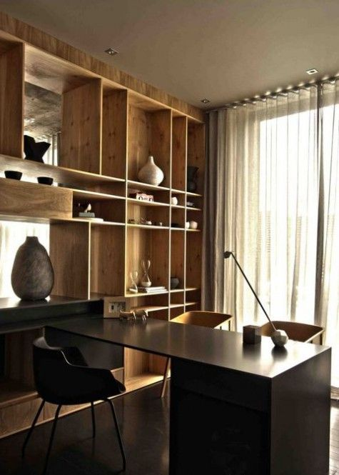 these light wood shelves contrast with a black desk and create a bold display feature