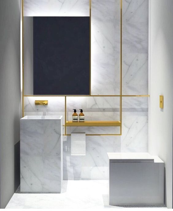 white marble and brass look edgy and stylish together, and simple shapes highlight the materials