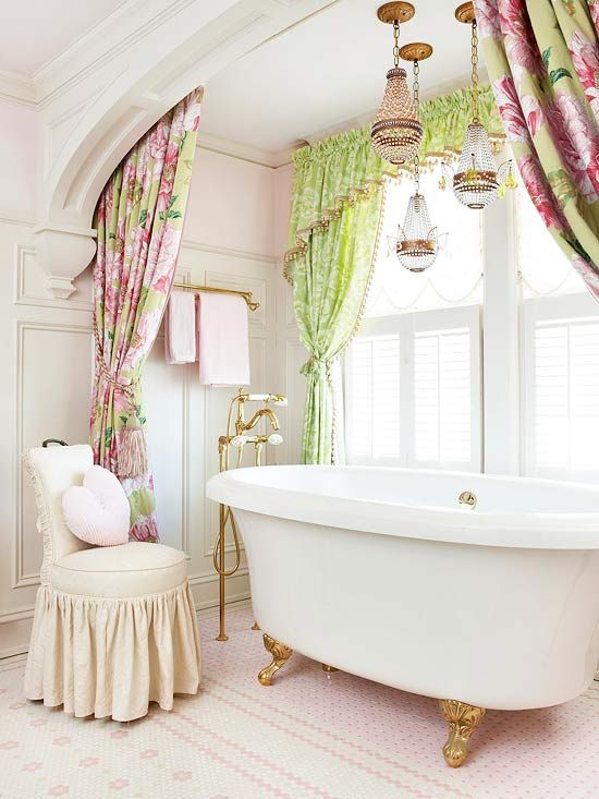 a girlish space with a white tub on gilded legs looks cute