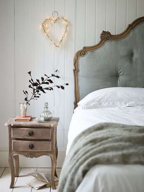 a refined rustic bedside table with a shabby chic feel
