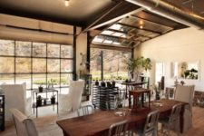 17 a sectional glass garage door used in an eclectic living room with adjacent outdoor spaces