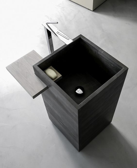masculine sqaure dark sink with an integrated wooden shelf for soap