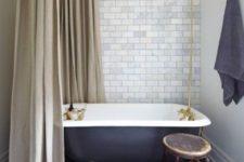17 retro-inspired bathroom with a black clawfoot tub on metallic legs looks very elegant
