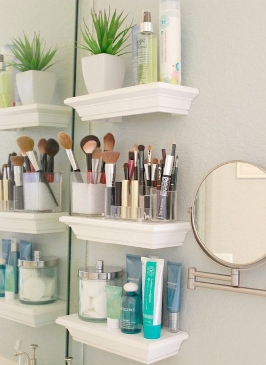 small floating shelves next to the bathroom mirror for storing all your  makeup