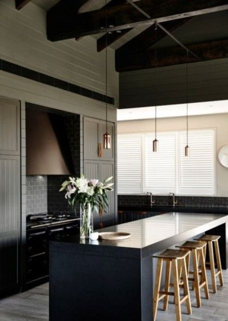 a black stone countertop is a durable solution and looks cool with light-colored stools
