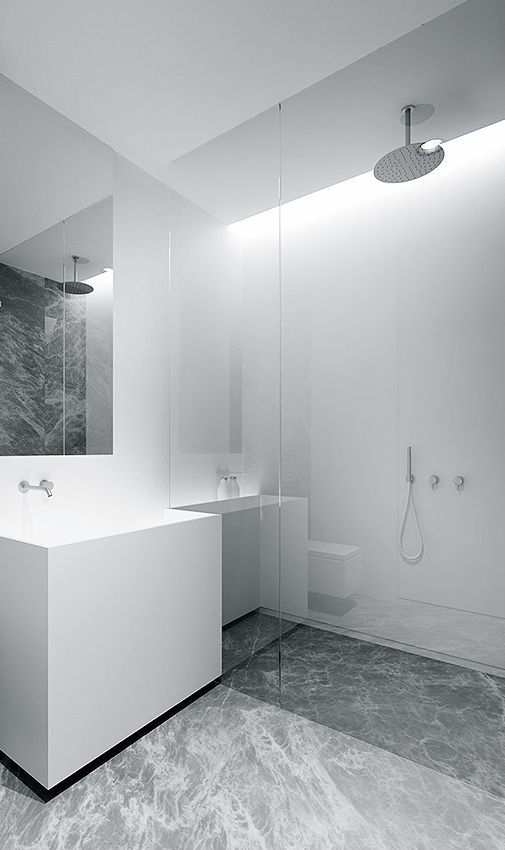 a minimalist square white sink for a minimal bathroom