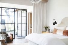 18 a modern bedroom with layered rugs and a chic crystal round chandelier of bubbles