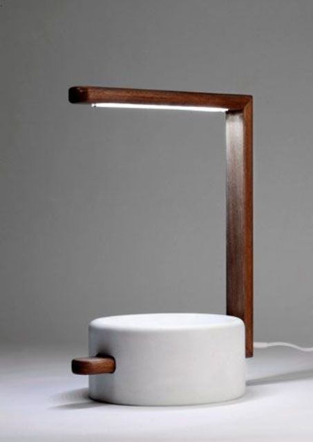 a table lamp in wood and a composite of marble powder and resin