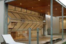 18 bi-fold garage doors open the living room to the outdoor spaces