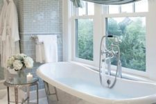 18 vintage-inspired bathroom with a metal-clad bathtub next to the window