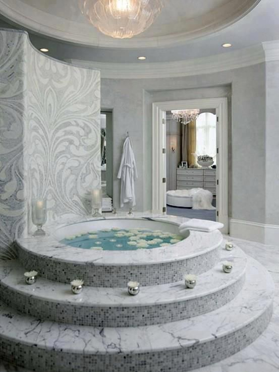white marble steps make your bathroom seem luxurious