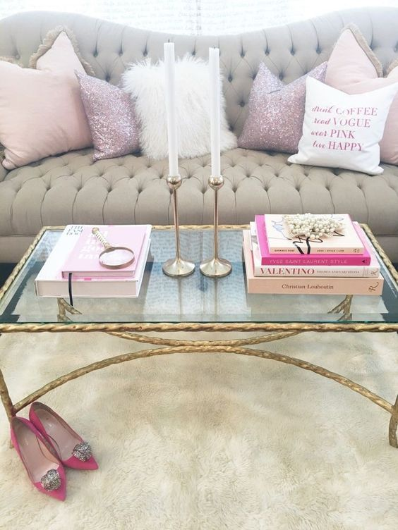 a gilded leg and frame table with a glass top is the most glam idea possible