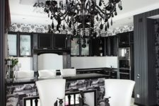 19 a modern black glam chandelier with black crystals is a fresh take on a traditional vintage one