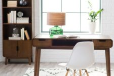 19 a modern green glass lamp with a wood grain lampshade catches an eye
