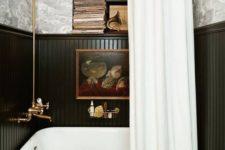 19 an elegant black tub in a black wood covered niche plus a shower