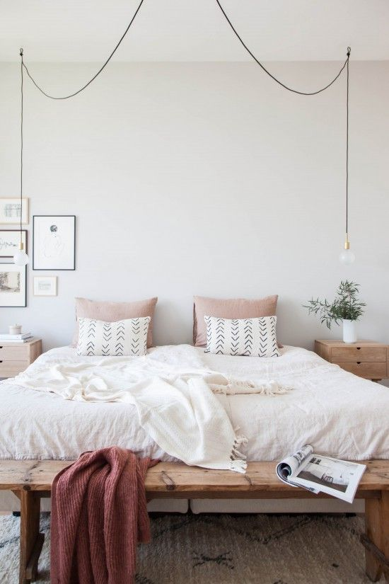 bulbs hanging on each side of the bed look modern and simple