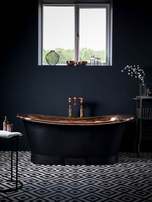 charcoal bathtub with a copper finish inside for an art deco space
